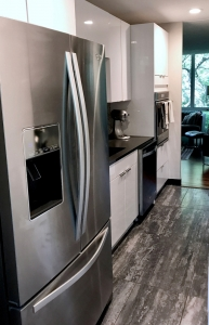 silver refrigerator and white kitchen cabinets