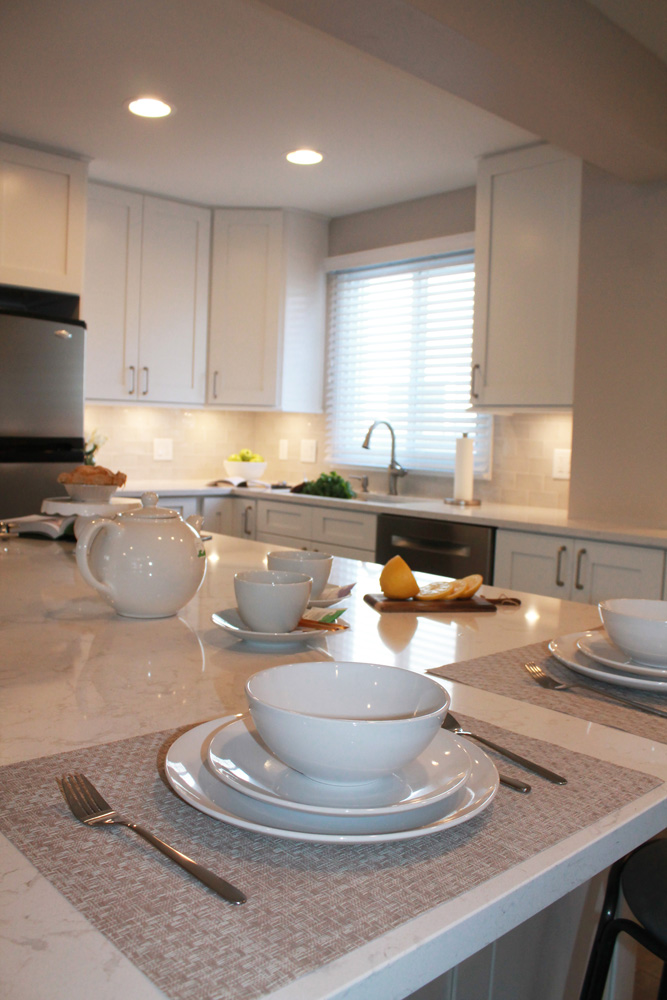 white kitchen table with dishes and silverware