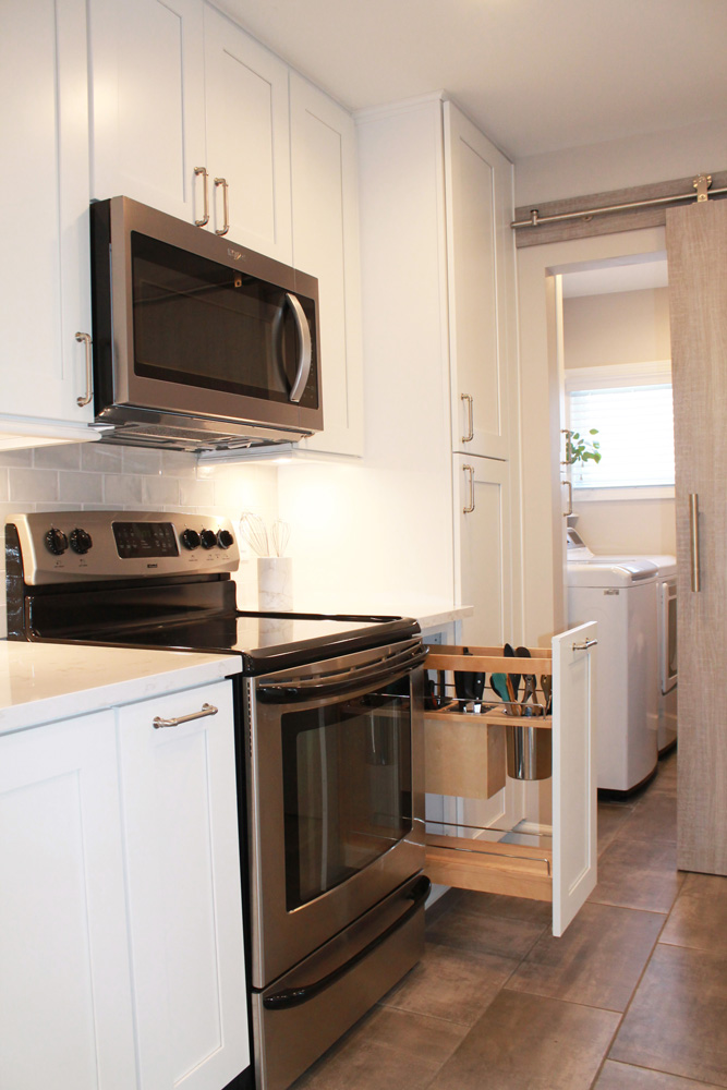 new white kitchen cabinets with a silver stove