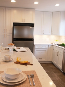white granite countertop with white kitchen cabinets
